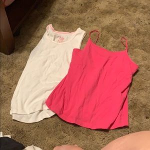 Pink and white tanks